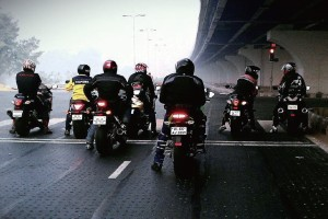 The motorcycle diaries: Anand Prasad (in yellow) and his entourage hammer down Delhi's streets.