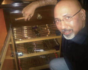 A luxury indulgence: Neeraj Tuli shows off his cigar collection.