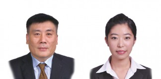A photo of Li Dongming who is a partner and Yang Lu who is a trainee lawyer at East & Concord Partners