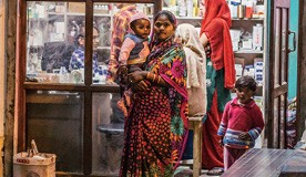 Woman_with_her_baby_outside_Indian_pharmacy