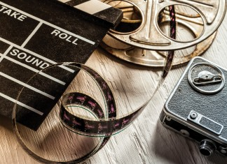 Vintage_film_reel,_camera_and_director_board