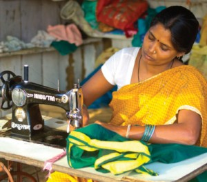 Woman_tailoring,_sewing_sari