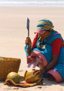 Indian_woman_cutting_coconut-Probiotic_food
