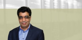 A photo of Deepak Sabharwal on an article about commercial courts act